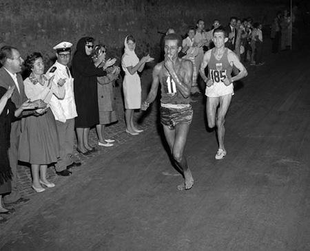 Abebe Bikila barefoot running Olympic marathon in Rome, 1960